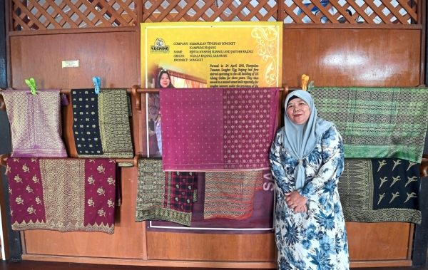 One of a kind: Saanah showing some songket pieces at the Sarawak Songket Weaving Centre in Sibu.  u2014 Bernama