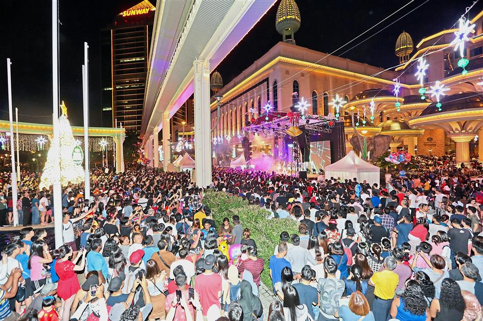 Thousands gathered in front of Sunway Resort Hotel & Spa for the New Year countdown party.