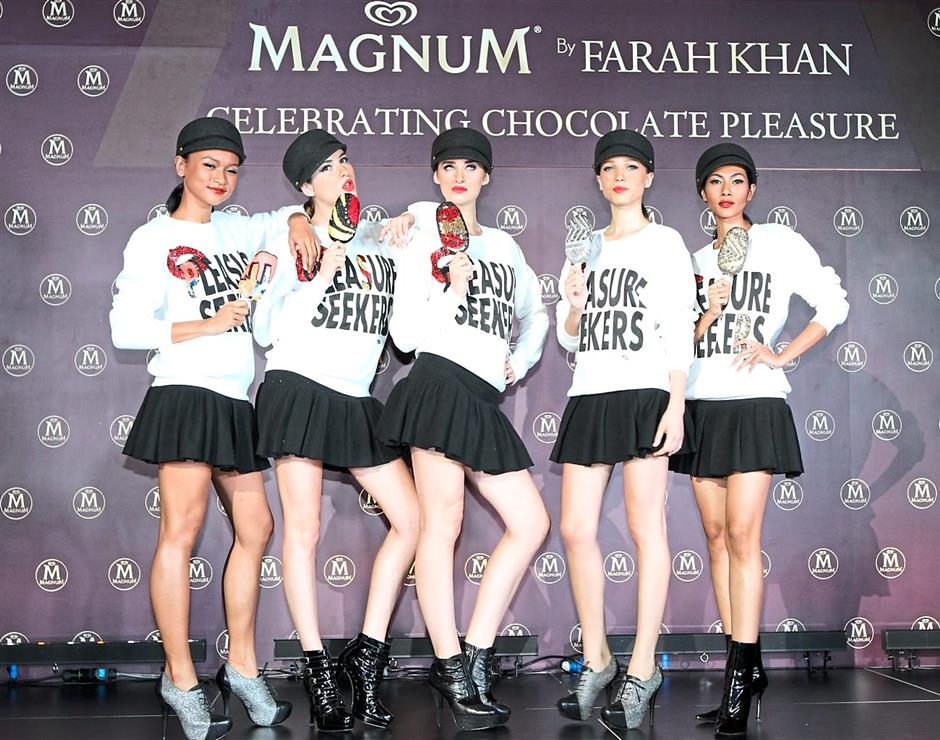 Stylish and glamorous: Models in the limited-edition Magnum-inspired Farah Khan sweatshirts, each holding a Magnum Precious Model created by Farah Khan exclusively for Magnum KL.