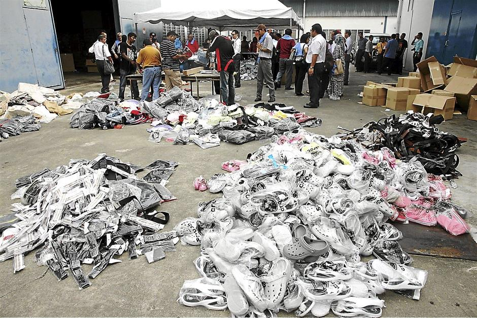 Thousands of fake branded goods worth RM1.3mil that were disposed by the Johor Domestic Trade, Cooperatives and Consumerism Department in Johor Baru,Johor on May30.