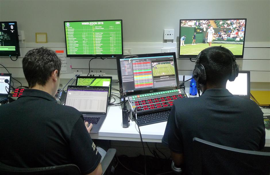 Staff monitor game data and work on match analysis at an operations room during the Wimbledon Tennis Championships in London, Wednesday, July 3, 2019. The All England Club is adding technology enhancements at this yearu2019s tournament aimed at eliminating bias from highlights that are chosen by computer artificial intelligence. (AP Photo/Kelvin Chan)