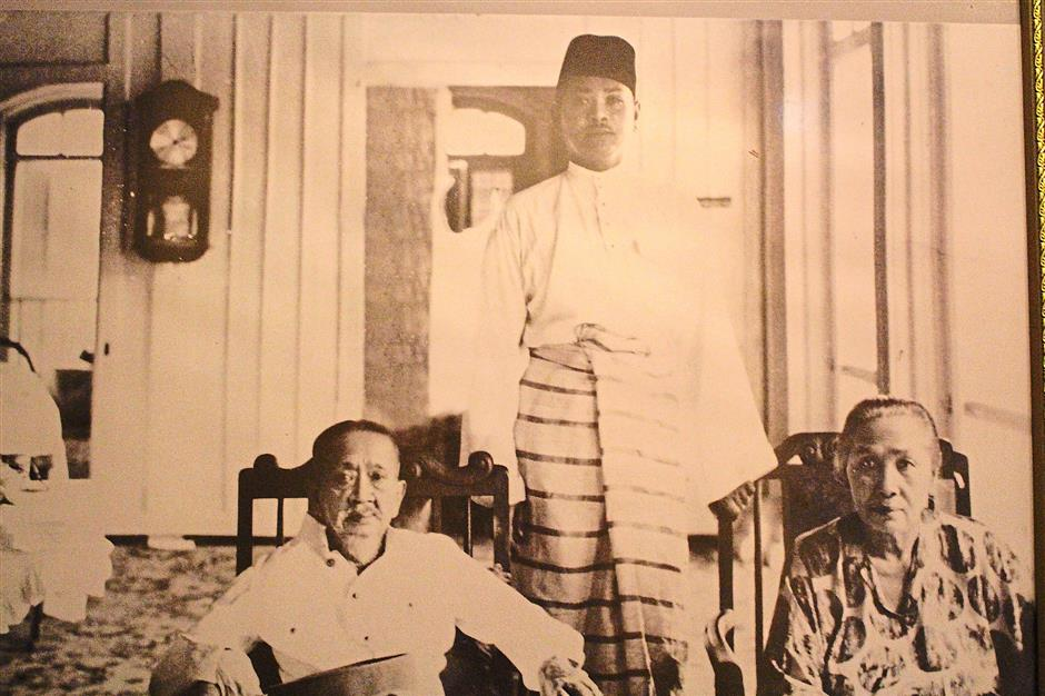 A young Tunku Abdul Rahman Putra Al-Haj with his Mother and Father.