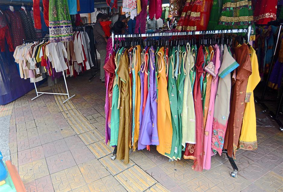 A shop in Brickfields has even placed a few clothes stand on the tactitle pathway, causing an obstruction to pedestrians.