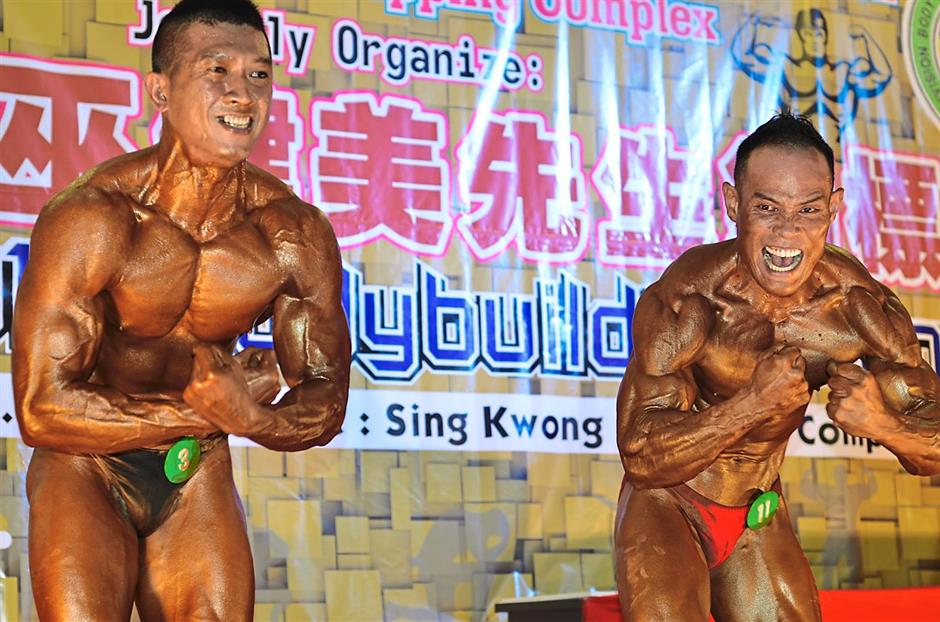 Strong men: Tee (left) and Akmal in a powerful pack pose for the Champion of the champions title.