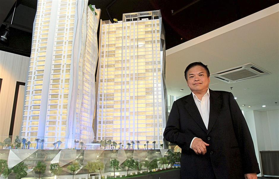 Premier De Muara chief executive officer (property and construction) Steven Hooi Kok Hoe with a model of Picasso Residence