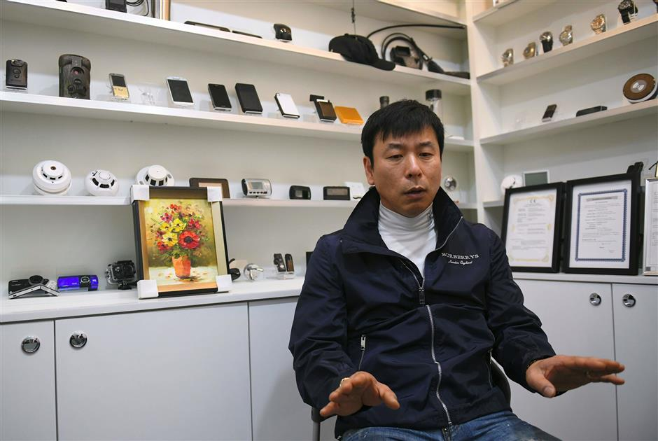 This picture taken on March 22, 2019 shows Shin Jang-jin, CEO of spy camera company Damoacam, during an interview with AFP at his shop in the port city of Incheon. - Spycam business is facing an increasingly negative public sentiment after a series of hidden camera scandals hit the ultra-wired South Korea, where many women fear daily of being secretly filmed by so-called 'molka', or spycam videos, in schools and toilets, among other places. (Photo by JUNG Yeon-Je / AFP)