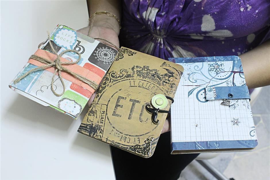 Thoughtful presents: The lovingly crafted journals made by Wong (left) will be making their way under the tree this Christmas.