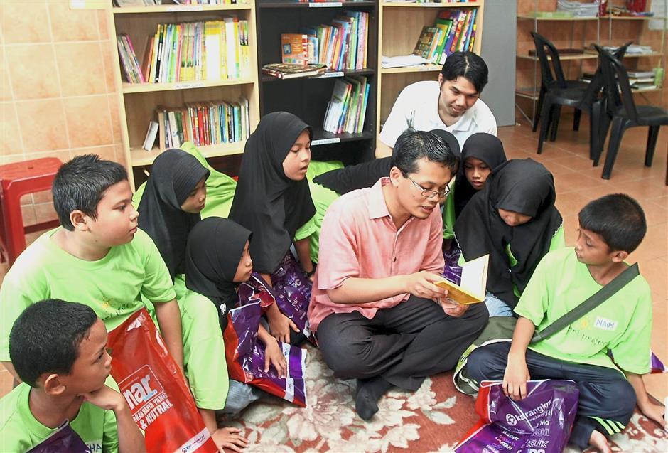 Making learning fun: Nik Nazmi wants to replicate the community library he initiated in his old constituency Seri Setia in his new area Setiawangsa.