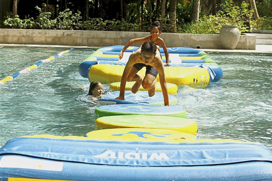 Kids can develop their water confidence and sense of balance playing at AK Academy at the  park.