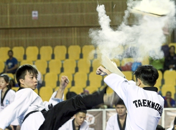 Universiti Tunku Abdul Rahman's Taekwondo Club members delivering an energetic performance during the closing ceremony of the championship.