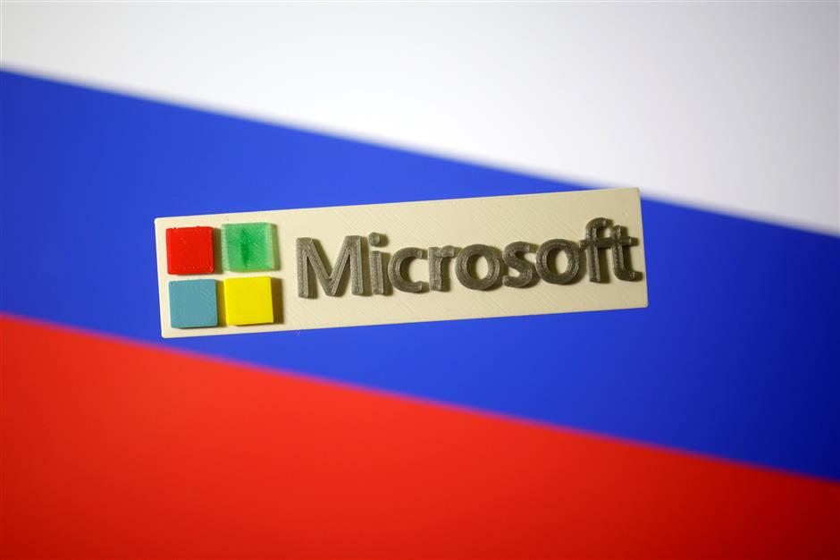 A 3D-printed Microsoft logo is seen on a displayed Russian flag in this illustration taken January 12, 2018. Picture taken January 12, 2018. REUTERS/Dado Ruvic/Illustration