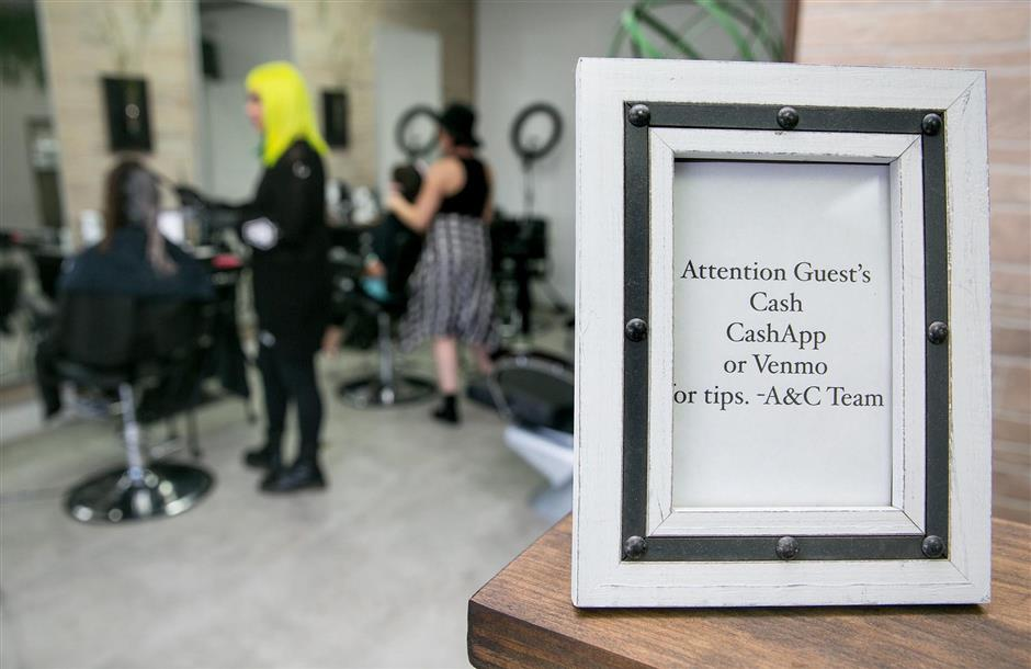 Art & Chemistry Beauty Lab, uses Venmo or CashApp for customers to pay her hair salon services on Thursday, Aug. 23, 2018 in Miami. (C.M. Guerrero/Miami Herald/TNS)