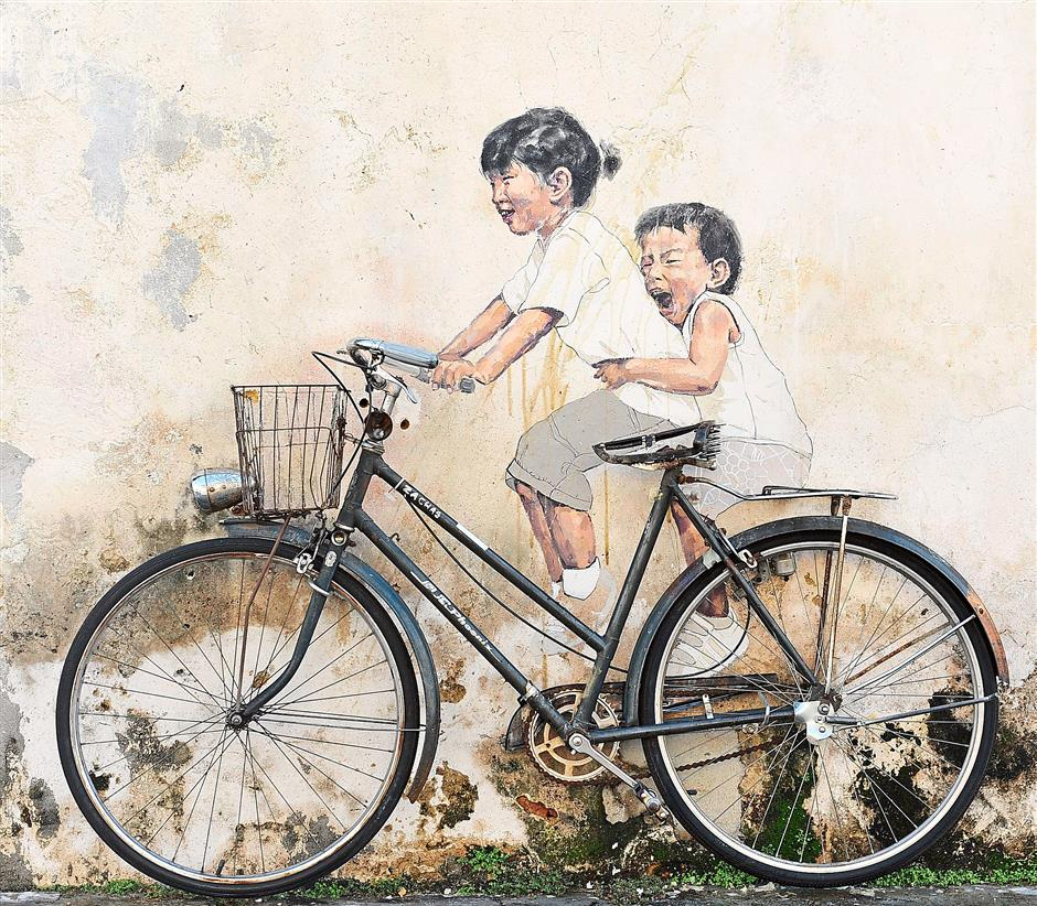 The Mirrors George Town street art project created by Lithuanian artist Ernest Zacharevic. Bits of wax are still stuck on the painting.
