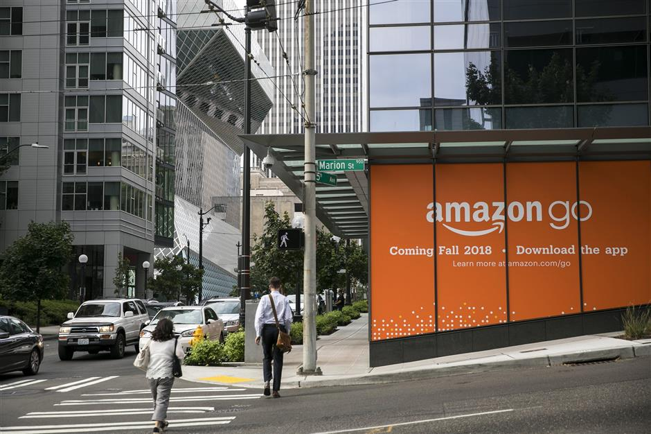 Amazon Go is preparing to open its second location in Downtown Seattle at Fifth Avenue and Marion Street in the Madison Centre building. The Seattle Public Library is seen in the background just north on Fifth Avenue. (Bettina Hansen/Seattle Times/TNS)