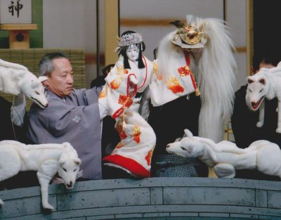 <b>Working in unity:</b> Staging the Bunraku requires the teamwork of three puppeteers.