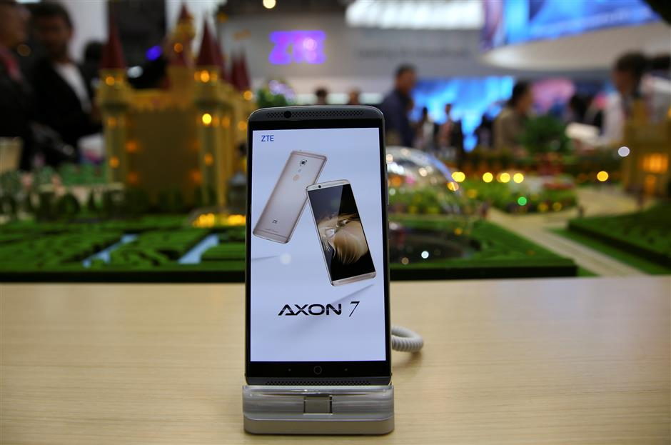 FILE PHOTO: A ZTE Axon7 device is displayed at company\'s booth during Mobile World Congress in Barcelona, Spain, February 27, 2017. REUTERS/Paul Hanna/File Photo                       GLOBAL BUSINESS WEEK AHEAD