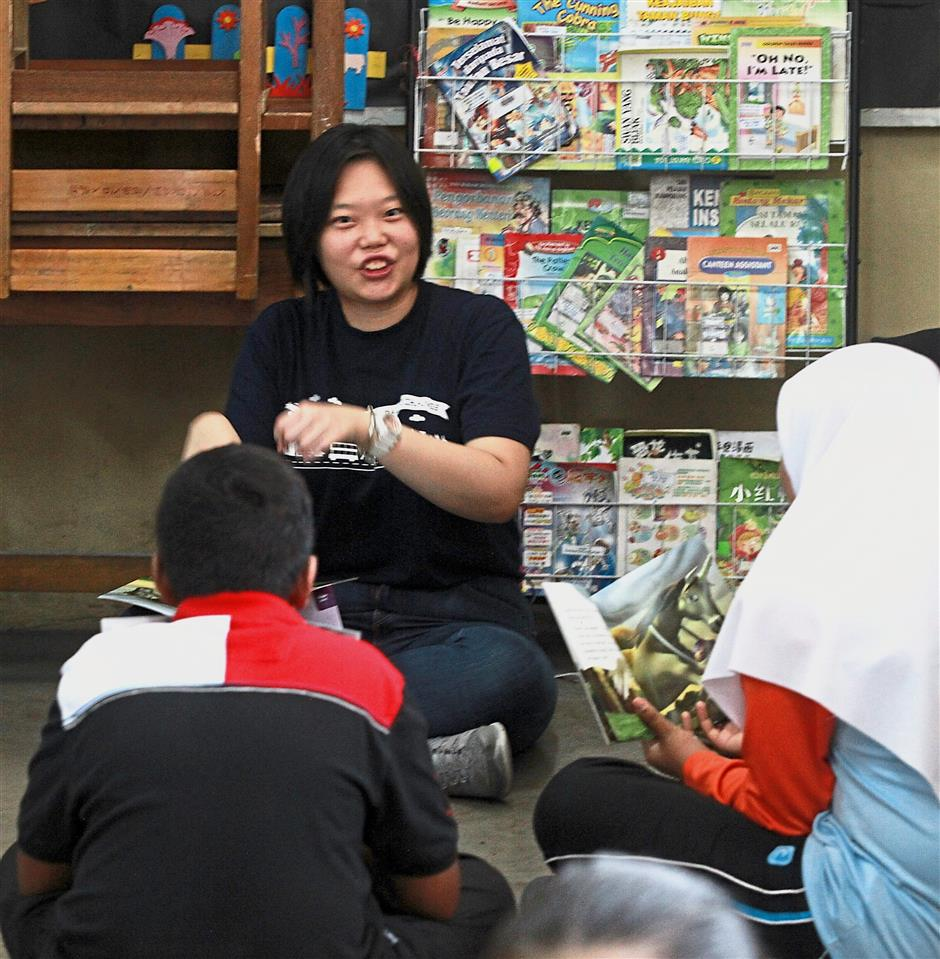 Sunway University students spend time on fun-filled language activities with the pupils.