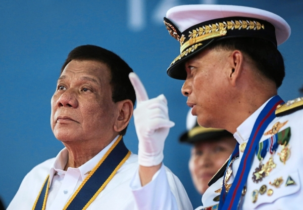 Meeting of minds: Duterte (left) talking to Philippine Navy Flag Officer-in-Command Vice-Admiral Robert Empedrad during the Navyu2019s 121st anniversary at Sangley point, Cavite province, Philippines. u2014 AP