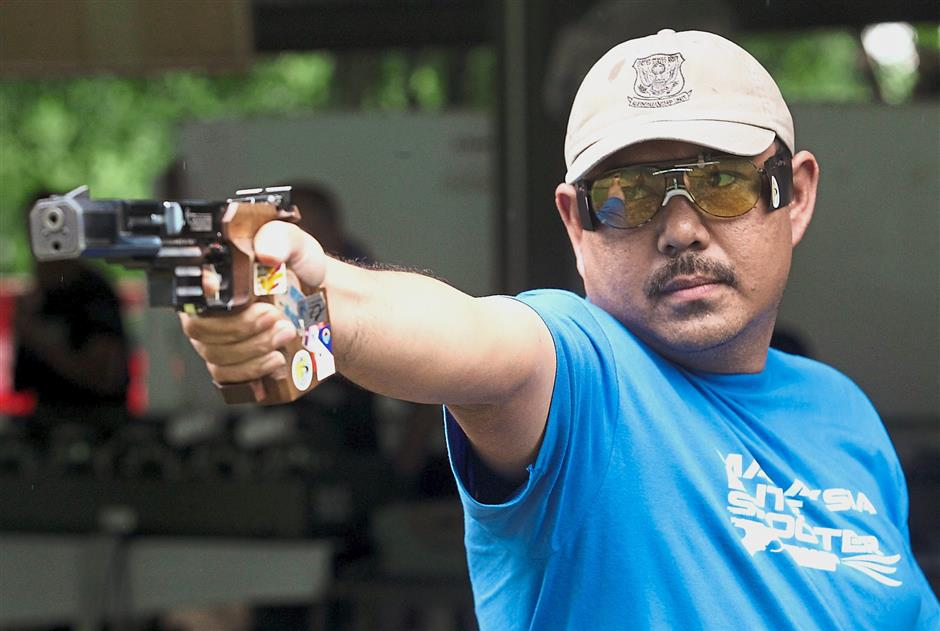 Hasli Izwan Amir Hasan in action for the 25m rapid fire pistol event at the Tun Hanif Cup shooting championship in National Shooting Range Subang
