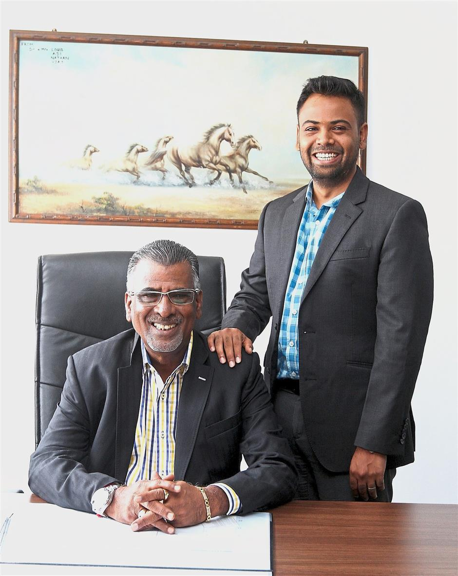 Keeping with the times: Karunanidhi (seated) and Ravin believe hard work and the willingness to change have made the company stronger.
