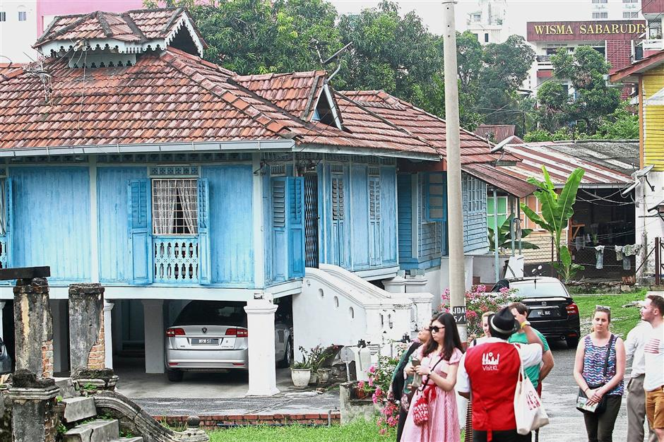 The Jalan-Jalan Kampung Baru guided tour was an opportunity for visitors to experience a Malay  village. — filepic