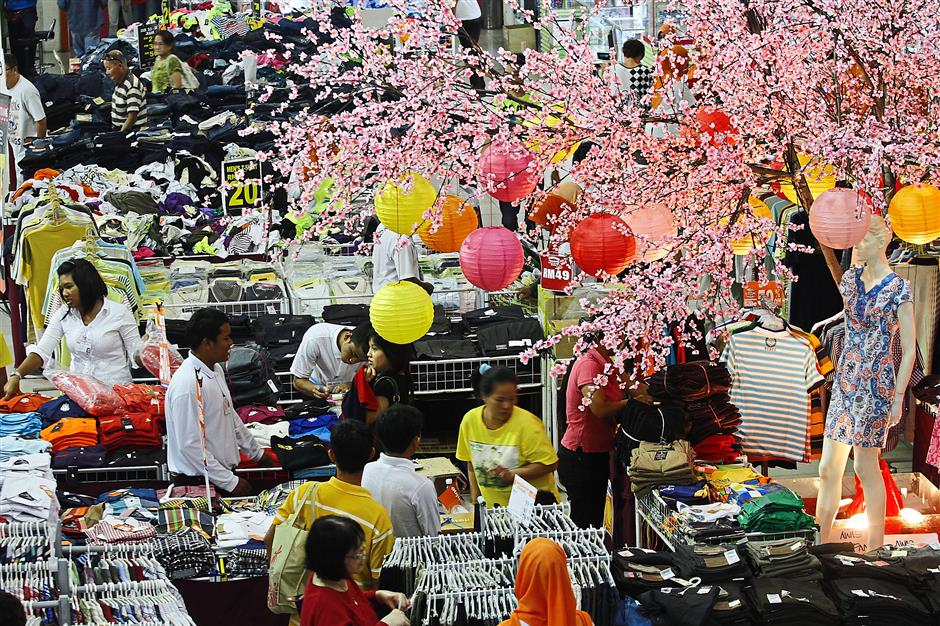Getting into the mood: Cherry blossoms and colourful lanterns punctuate the shopping areas at Sunshine Square.