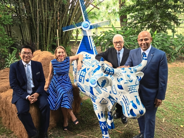 (From left) Sim, Mossenlechner, Dutch Lady Milk Industries Bhd chairman Zainal Abidin Putih and managing director Tarang Gupta at the launch of the Farmer2Farmer Programme 2019. u2014 LOW BOON TAT/The Star