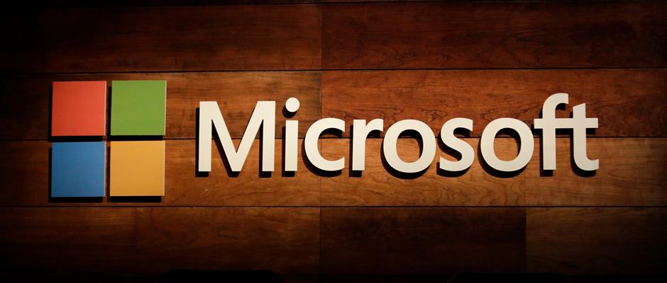 (FILES) This file photo taken on November 30, 2016 shows the Microsoft logo pictured at the Microsoft Annual Shareholders Meeting in Bellevue, Washington. Microsoft on October 26, 2017 delivered stronger-than-expected earnings for the past quarter, lifted by gains in cloud computing and other business services. For its first fiscal quarter to September 30, the tech giant said profit was up 16 percent from a year ago to $6.6 billion.  / AFP PHOTO / Jason Redmond