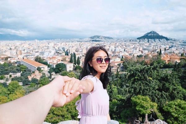 Fellicia in an Instagram travel photo taken by her husband Handy. — Instagram