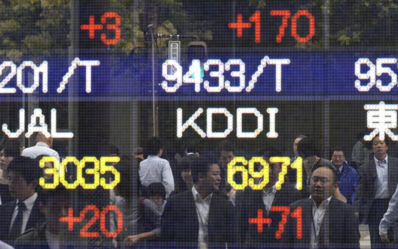 It\'s happy days at the Japan stock market after the Bank of Japan\'s announcements that its ultra-easy monetary policy will get even more loose, as Japan\'s huge pension fund also pledging to double its equity holdings - EPA Photo.