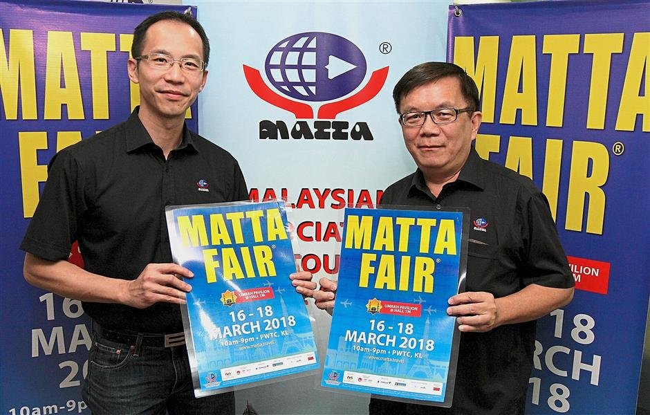 Back in a MATTA of time: Wong (left) and Phua at a press conference announcing the upcoming MATTA fair to be held at PWTC in March.