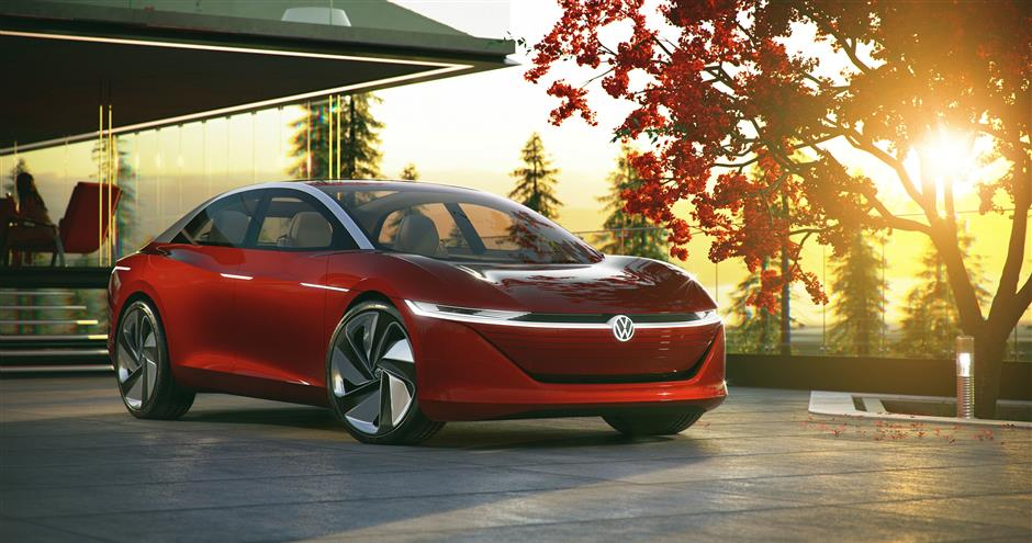 HANDOUT - Volkswagen's ID Vizzion is a sleek limousine that drives itself and communicates with passengers via voice and gesture control. Photo: Volkswagen AG/dpa