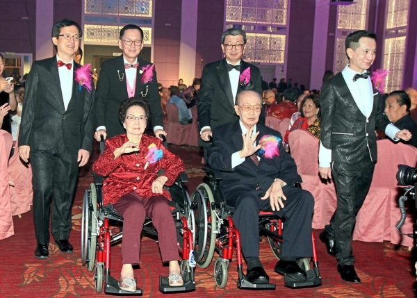 (From left) Hock Sing, Hock Guan, Hock San and Hock Seong making an entrance with their parents.