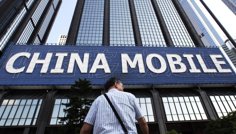 China Mobile, the worldu2019s biggest phone company by users, has been seeking overseas acquisitions after its cash rose to US$69bil by the end of March - Reuters Photo.