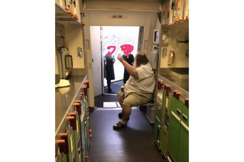 Overweight passenger forces EVA Air flight attendants to