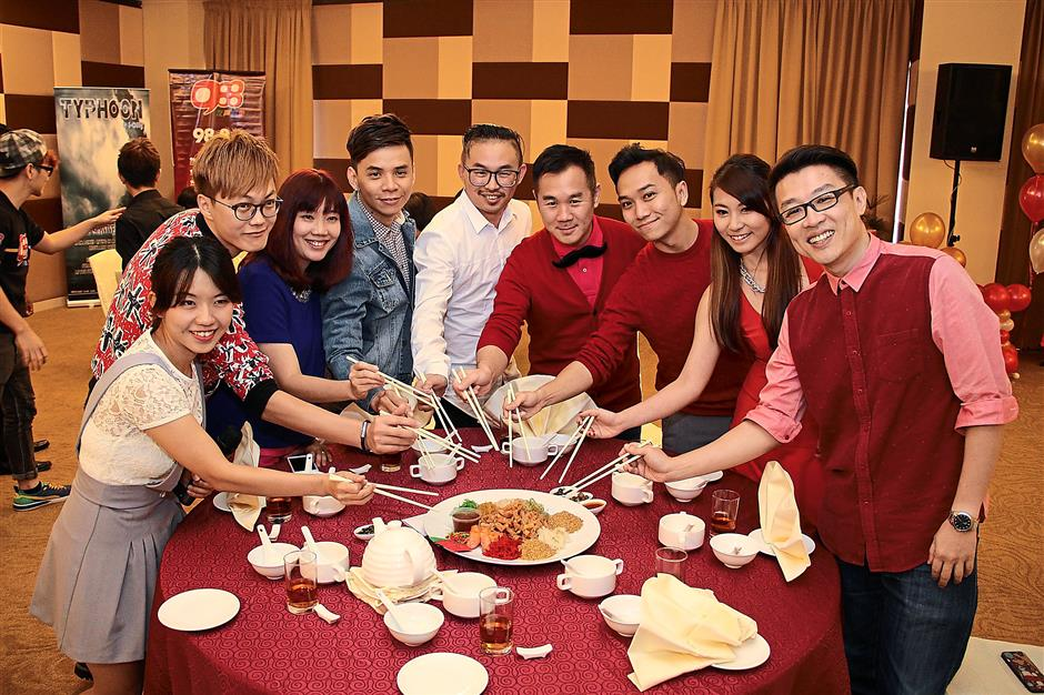 For prosperity: (From left): May, Jason, Sam, Danny One, Zhuang Xue Zhong, KK, Anson, Cassey and PM Wong tossing 'yee sang' to usher in the new year.