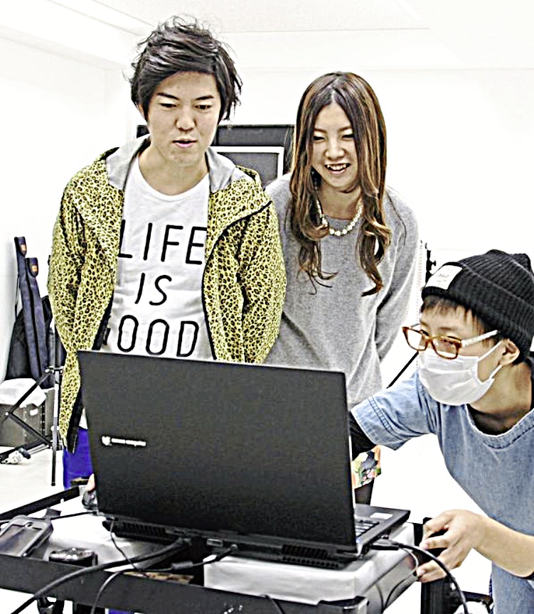 Makoto Shimizu and his wife, Rie, check the 3D data on a computer after they were scanned.