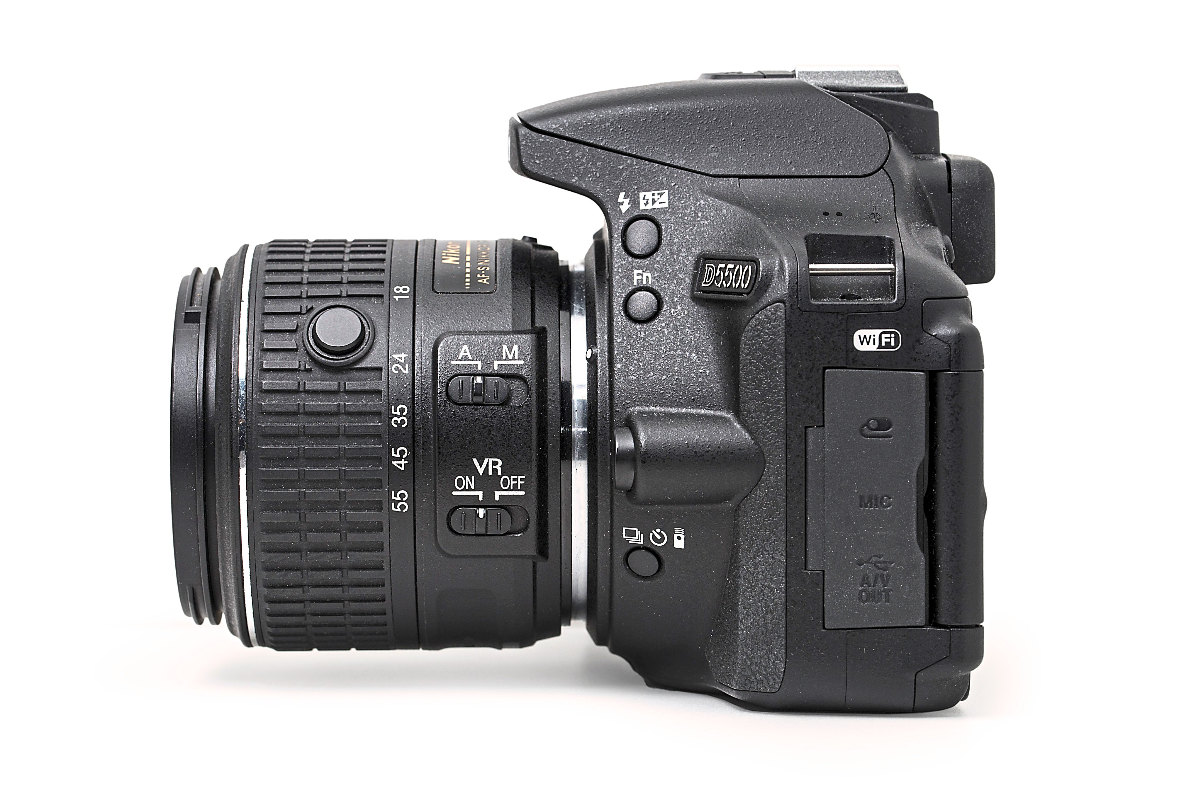 The Nikon D5500 with the 18-55mm collapsible kit lens. The button on the lens allows you to twist the zoom ring into its fully closed position.