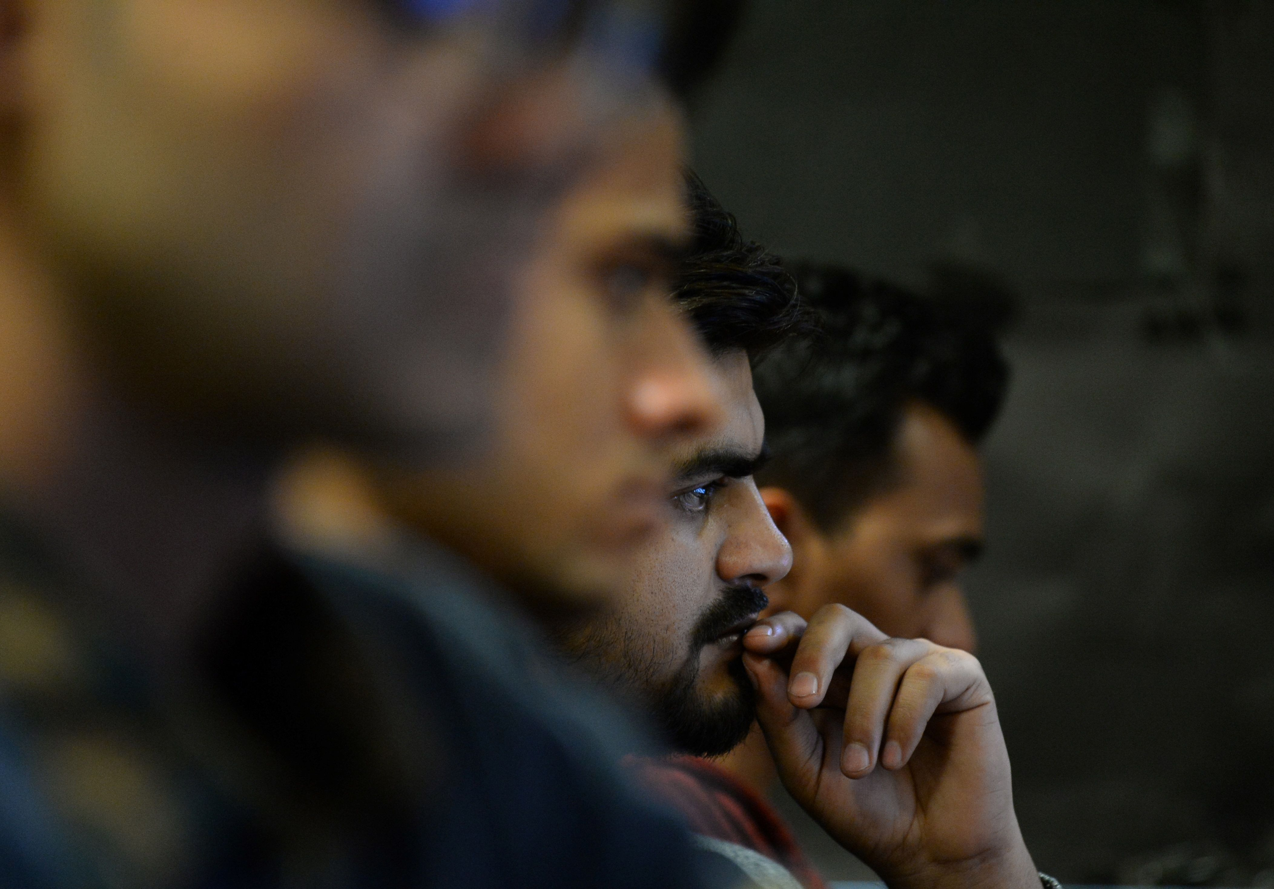 In this photograph taken on December 13, 2016, employees of Indian IT security solutions company Innefu Labs works at their offices in New Delhi.  In the darkened offices of a tech start-up, a handful of computer engineers sift through a mountain of intelligence data that would normally be the work of a small army of Indian security agents. / AFP PHOTO / SAJJAD HUSSAIN / TO GO WITH AFP STORY: India-Technology-Security-Cyber, FOCUS by Megha BAHREE