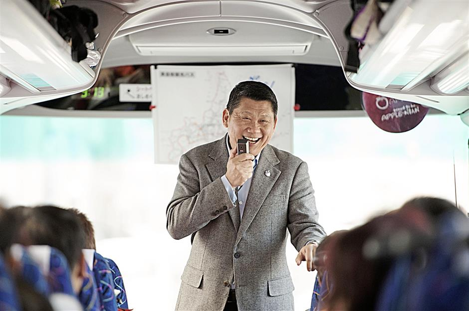 Despite his position in the company, Lee still takes time to lead tour groups.