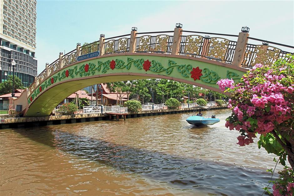 The Kampung Morten bridge over the Melaka River is another popular attraction in the village.