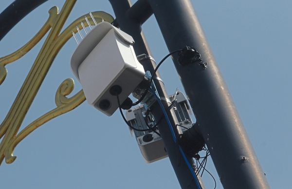 A closeup of the Terragraph device (above) and the device after being installed on a lamp post (right) near the City Hall in Penang.