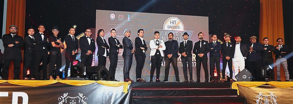 Faces of the future: The 20 barbers who underwent the HIT Barber programme posing onstage during the HIT Barber Award Nite 2017 at the Premiera Hotel.