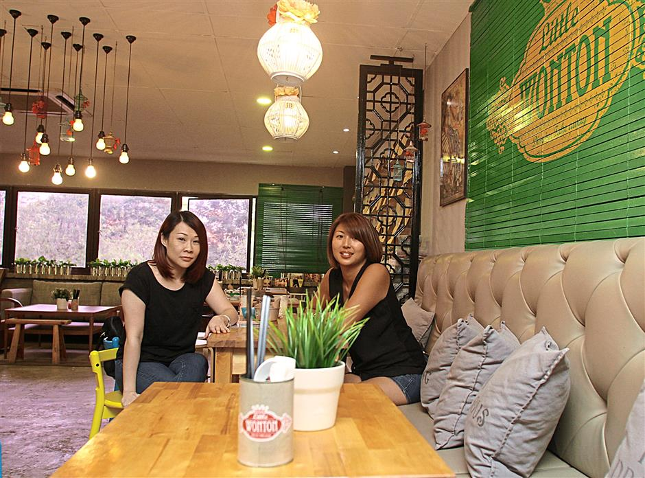 Friends of 20 years, Bernice Cheong, 38 (left), and Elyn Pow, 37 (rigth), decided to open up Little Wonton after Pow experimented on snack foods in her own kitchen. The eclectic little eatery offers air-fried savoury and dessert wontons as well a nutritious charcoal noodles that vary from Western inspired dishes to local flavours.