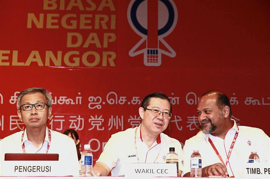 Changing of the guards: (From left) Pua, DAP Secretary-General Lim Guan Eng and Gobind during the Selangor DAP Convention in Petaling Jaya.