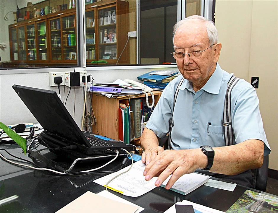 iphvincent... Datuk Brother Vincent Corkery working in his office at the La Salle Centre, Ipoh.