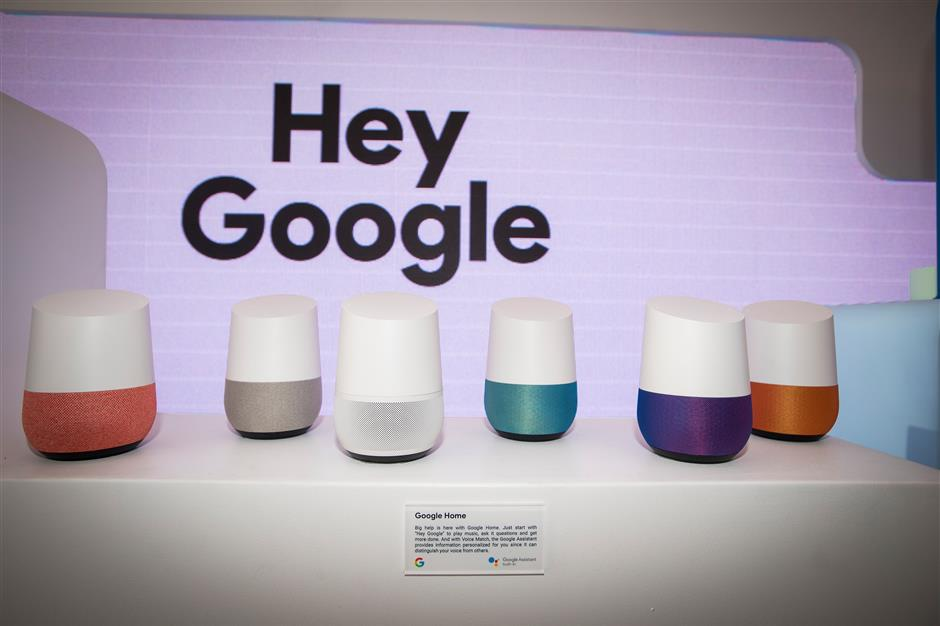 Google Inc. Home smart speakers are displayed at the company\'s booth during the 2018 Consumer Electronics Show (CES) in Las Vegas, Nevada, U.S., on Thursday, Jan. 11, 2018. Electric and driverless cars will remain a big part of this year\'s CES, as makers of high-tech cameras, batteries, and AI software vie to climb into automakers\' dashboards. Photographer: David Paul Morris/Bloomberg