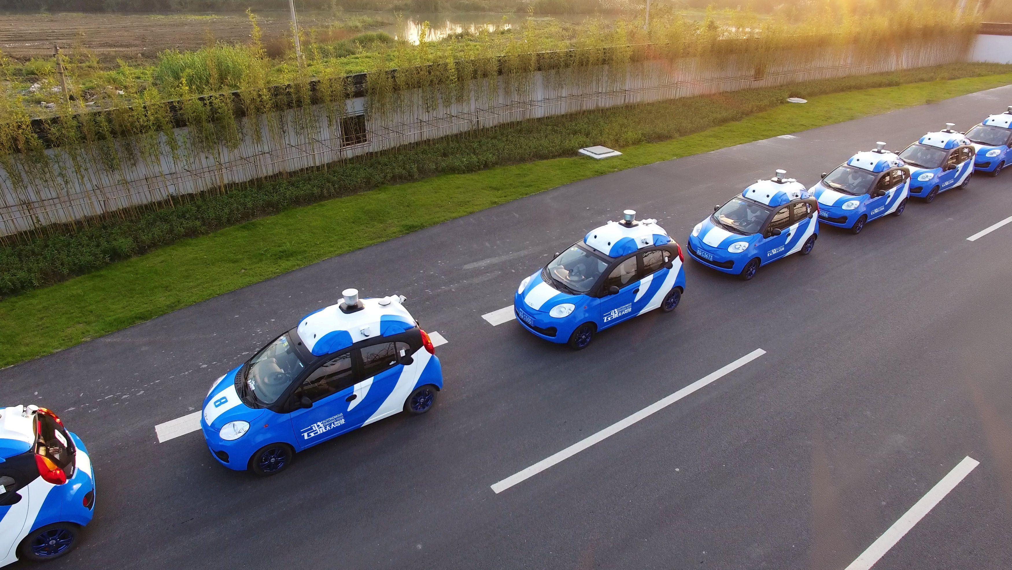 FILE PHOTO: A fleet of vehicles equipped with Baiduu2019s autonomous driving technologies conduct road testing in Wuzhen, Zhejiang Province, China.   Courtesy of Baidu/Handout via REUTERS/File Photo