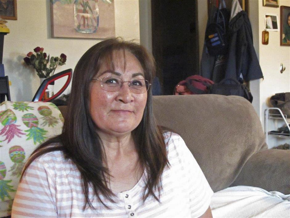 In this Thursday, Aug. 23, 2018 photo, Muriel Hopson Brower talks about the new Inupiat Eskimo language option now available for Facebook bookmarks, action buttons and other interface functions in Anchorage, Alaska. Alaskans made the option a reality through the social media giant's community translation tool. (AP Photo/Rachel D'Oro)