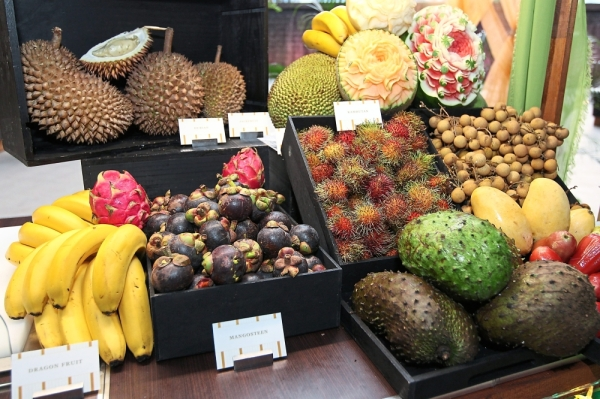 Assorted fruits including durian are available at the buffet.